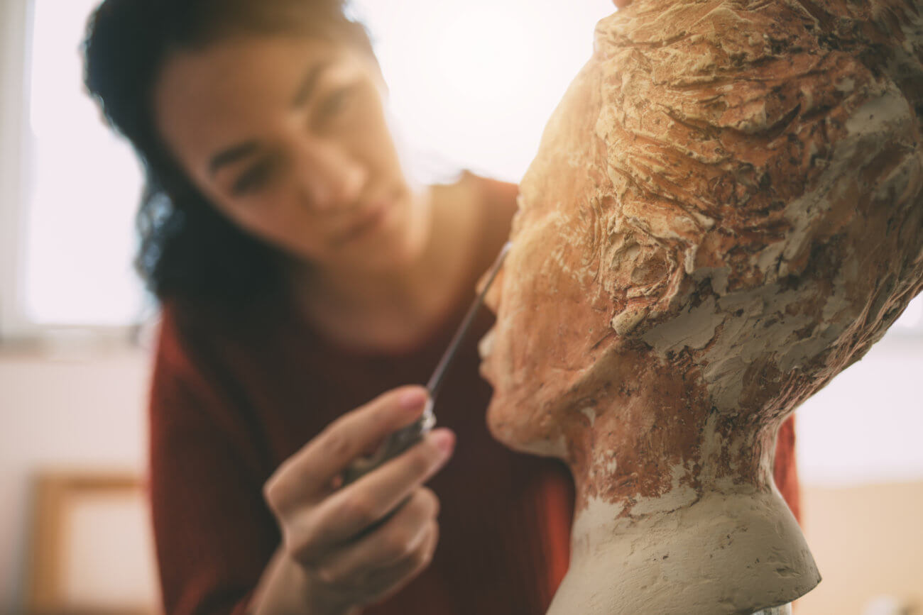 artist is working in an atelier art and sculpture